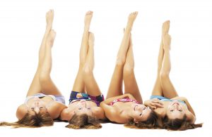 Four beautiful girls with perfect bodies, isolated on white